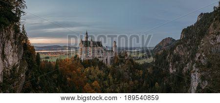 Panoramic view of Neuschwanstein Castle in the autumn Bavaria Germany. Autumn landscape