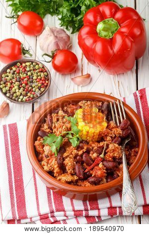 Homemade stewed spicy meat with beans corn and spices. Chili con carne. A dish of Mexican cuisine. Selective focus