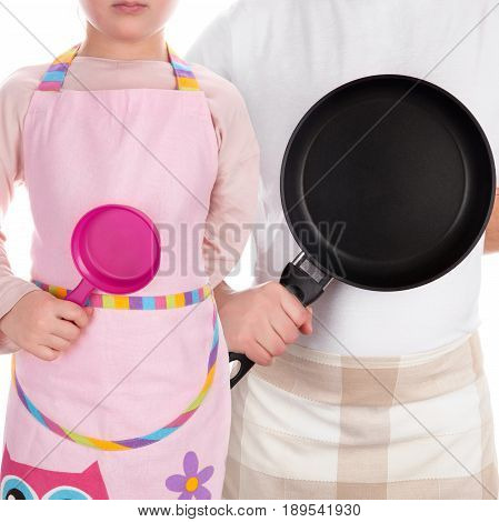 Father with daughter holding frying pans and preparing for cooking. Mentorship leadership and parenthood.
