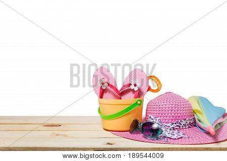 Beach accessoryhatsunglassesshoesumbrella on wooden concept summer holiday background and summer sale