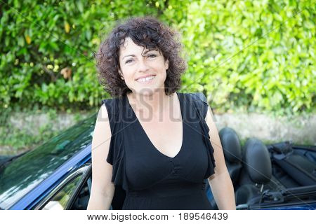 Forties Woman Front Of Blue Cabriolet Car