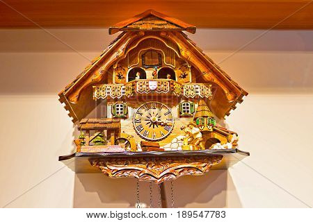 The detail of swiss wooden cuckoo clock