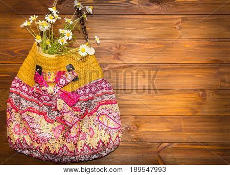 Bright Summer Accessories. Bag on wooden background