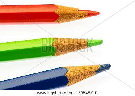color pencils of different colors red green abd blue on white background