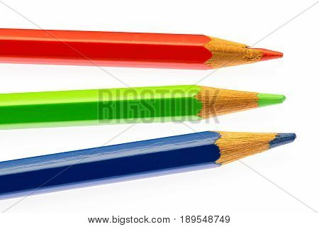 color pencils of different colors makink a color wheel on white background