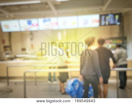 Blurred Image Of People Queue Up Waiting In Line To Buy Fast Food In Fastfood Store Or Seflservice R