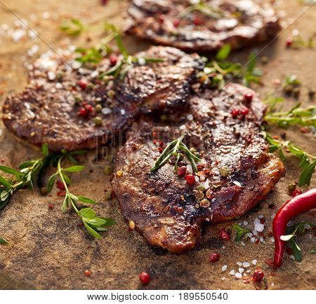 Grilled pork neck steak sprinkled with herbs and spices