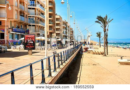 Guardamar del Segura Spain - May 26 2017: View to the promenade and sandy beach of Guardamar del Segura. Costa Blanca Spain