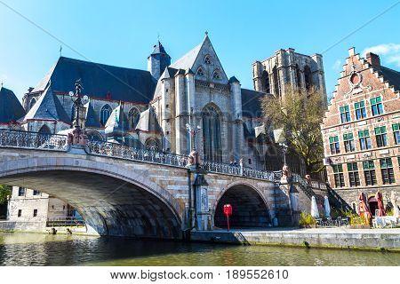 Ghent, Belgium - April 12, 2016: Medieval St. Michael Bridge, church, canal in Ghent, Belgium
