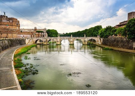 The Tiber River winding Rome and through the St. Angelo Bridge