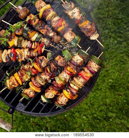 Grilled skewers on a grilled plate, outdoor