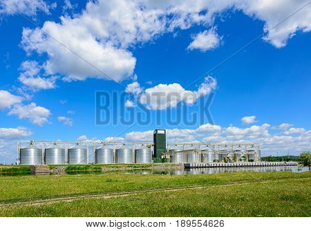 Grain Elevator In Agricultural Zone. Granary With Mechanical Equipment For Receiving, Cleaning, Dryi