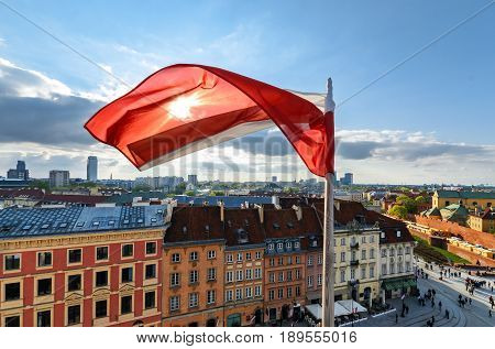Poland Flag on Blue Sky and centre of Warsaw Background