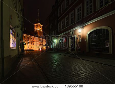 Royal castle and old town street at night in Poland Europe