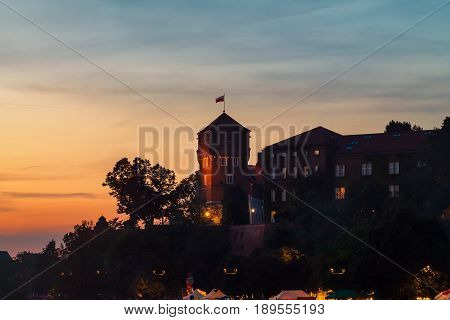 Castle tower on Wawel hill in pink red sunset Krakow Poland Europe.
