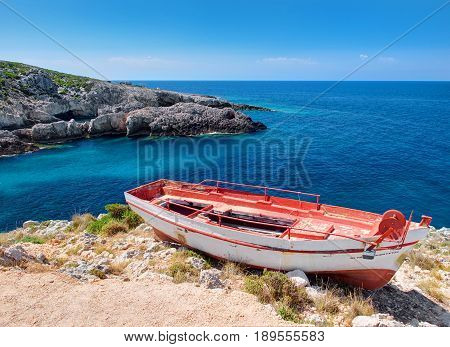 Old red and white very old boat and beautiful view on blue water of Ionian sea on Island Zakynthos in Greece. Sightseeing point for tourists. Greece holidays in Porto Limnionas Tavern. Greece islands