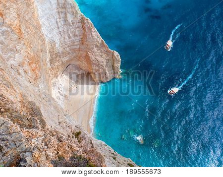 View on two touristic boats going to Blue Caves and sand beach in Ionian Sea blue water. Sightseeing point. Greece Islands Zakynthos holidays vacations tours tourism. Famous sightseeing places
