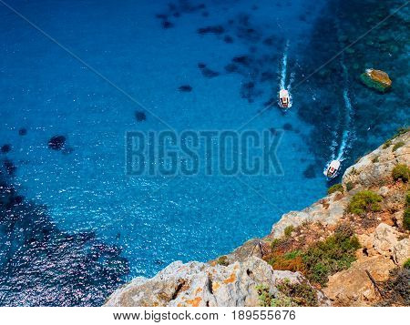 Beautiful view on two touristic boats going to Blue Caves reefs in Ionian Sea blue water. Sightseeing point. Two boats Greece Island Zakynthos holidays vacations tours tourism. Famous sightseeing