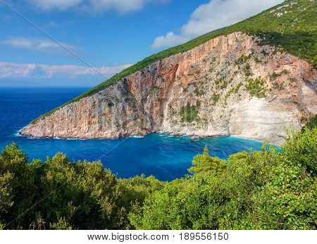 Beautiful view on Zakynthos Elation Sparto beach sea bay, stone rocks, blue water of Ionian Sea, Blue Caves. Love beach. Greece islands holidays vacations famous places tours. Green stone rock
