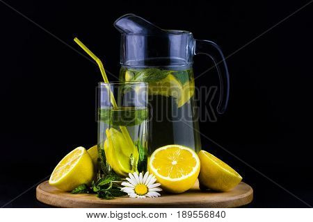 Fresh Lemonade With Lemon On Wooden Background