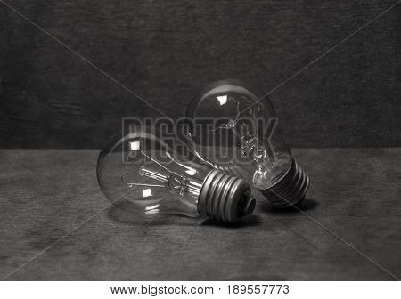 On the wooden table lie two lights