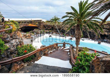 Lanzarote Spain - March 29 2017: People visiting volcanic cave in Jameos del Agua Lanzarote Canary Islands Spain