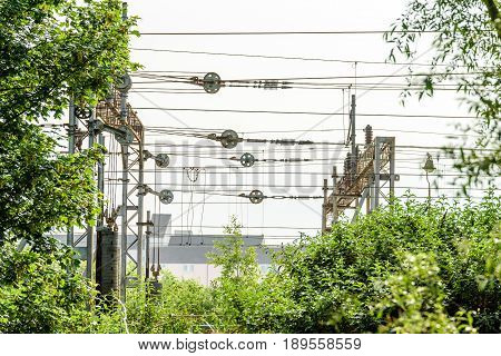 Metal high voltage electric supply cables over railway.