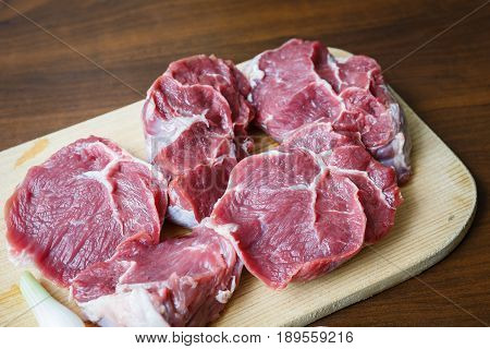 Fresh Raw Beef On Wooden Cutting Plate