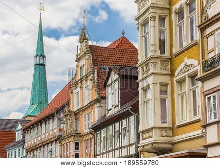 Colorful Facades And Church Tower In The Center Of Hameln