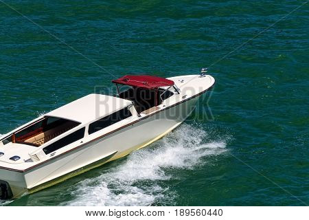 Luxury italian speedboat through the waters near Venice Italy