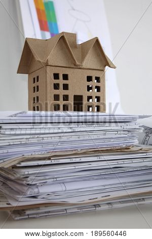 Image of new model house on architecture blueprint .
