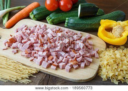 Ingredients For Cooking Italian Pasta - Spaghetti, Tagliatelle, Cherry Tomato, Zucchini And Salami.