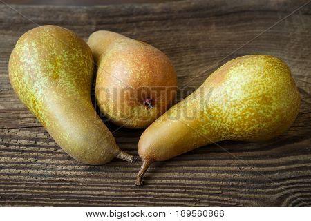Three Ripe Juicy Pears On Rustic Wooden Table