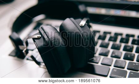 External Headphones Lying On The Keyboard Of The Close-up. Music Headphones For Recording Sound. Pro