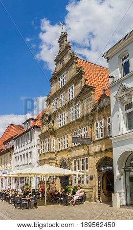 HAMELN, GERMANY - MAY 22, 2017: People enjoying the sun at restaurants on the central square of Hameln, Germany