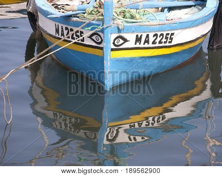 detail vintage boat painted with arabic text