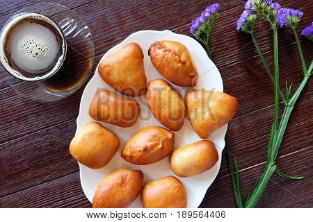 For Breakfast coffee, hotcakes and flowers on wooden background
