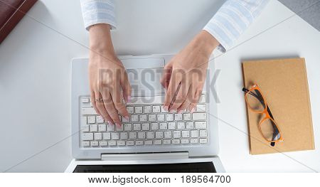 Female hands or woman office worker typing on the keyboard.