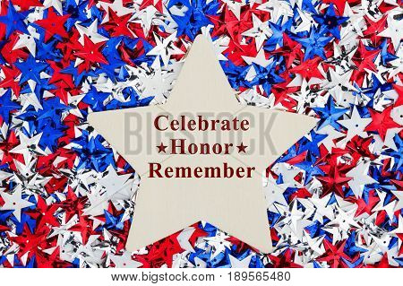 Patriotic Celebrate Honor Remember text on a wood star with USA red white and blue stars with wood star background