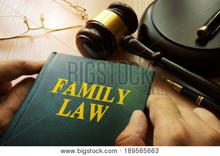 Family law on an office table and gavel.