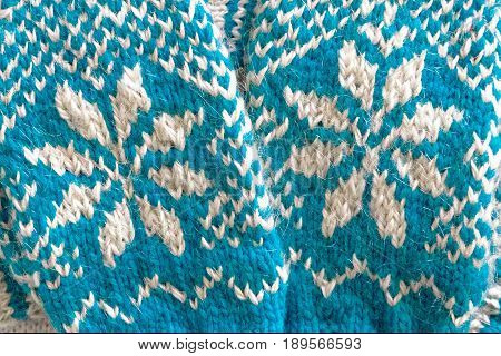 Knitted mittens and socks blue and white colors with h jacquard pattern poster
