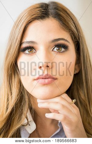 Pretty Girl With Hand On Her Chin