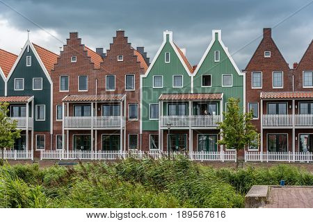 Veolendam Netherlands - August 08 2016. Houses in the marina of Volendam. Volendam is a popular tourist attraction in the Netherlands well known for its old fishing boats and the traditional clothing still worn by some residents