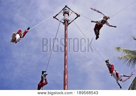The Danza de los Voladores (Dance of the Flyers) or Palo Volador (pole flying) is an ancient Mesoamerican ceremony/ritual still performed today in Mexico. It is believed to have originated with the Nahua Huastec and Otomi peoples in central Mexico. The ri