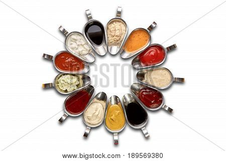 Sauces in metal sauceboats on a white background isolation