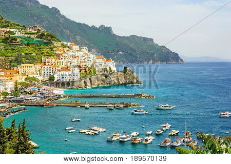 beautiful view of Amalfi town on Amalfi coast with yachts and boats Campania Italy