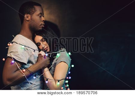 Happy Couple Man Woman Love Interracial Relationship Bound Together Tenderness Lights Holiday Ney Year Free Space Concept