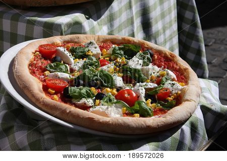 Fresh baked pizza on cutting board .
