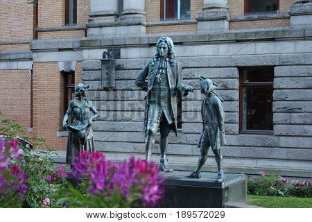 The statue of the Danish / Norwegian writer Ludvig Holberg 1684-1754 outside the Royal Theatre at Kongens Nytorv in Copenhagen.