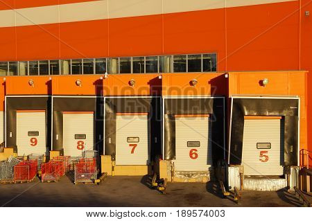 Loading and unloading docks of hypermarket from the back party of shopping center